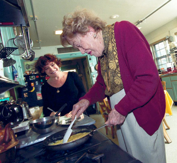Julia Child cooks scrambled eggs for me in her Cambridge MA kitchen in 1999. Her kitchen is now in the Smithsonian.