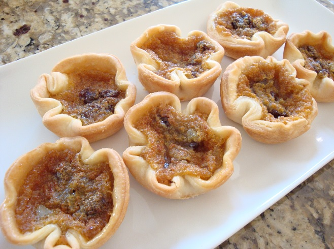 butter tarts on white plate