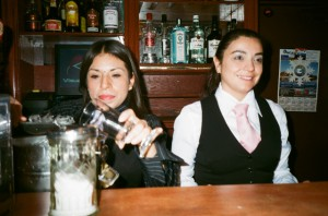 Elizabeth Goncalves (right), daughter of the late Amadeu, tends bar at Amadeu's